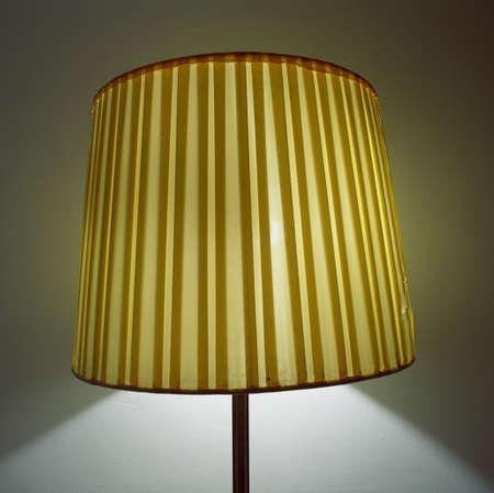 lamp shade: Illuminated electric lamp with shade, close-up