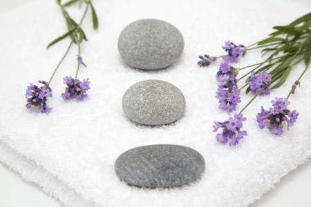 auras: Lavender, towels and pebbles, close-up