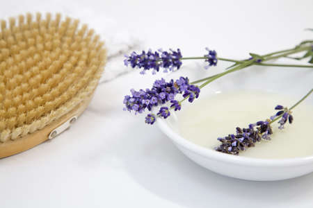 auras: Lavender flowers on plate by brush, close-up