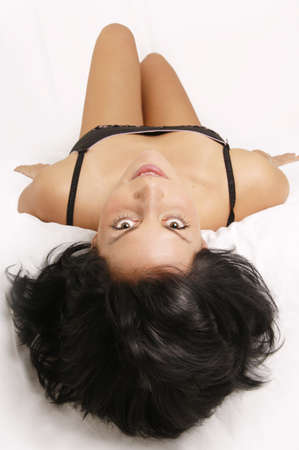 emot: Young woman lying in bed LANG_EVOIMAGES