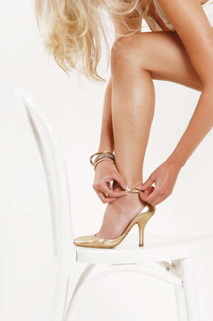 Woman putting on shoe,low section LANG_EVOIMAGES
