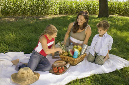 Mother with daughter and son at picnic LANG_EVOIMAGES