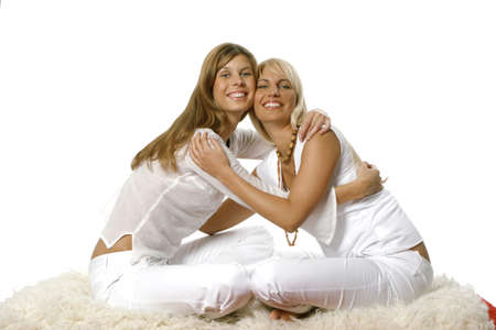 Two sitting woman embracing each other