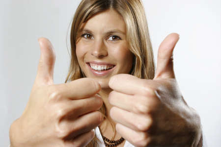 age 25 30 years: Woman with thumbs up