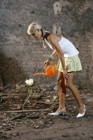 25 30 years: Woman watering one flower
