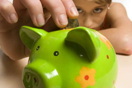 18 20 years: Young woman with green piggy bank, close-up