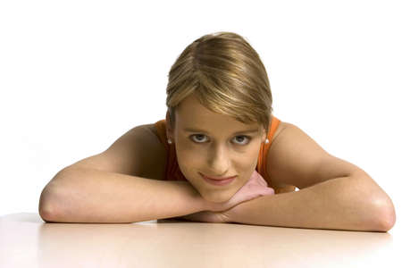 auspiciousness: Young woman leaning on table, portrait