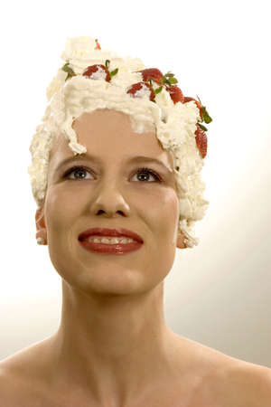 auspiciousness: Young woman with cream on head, close-up