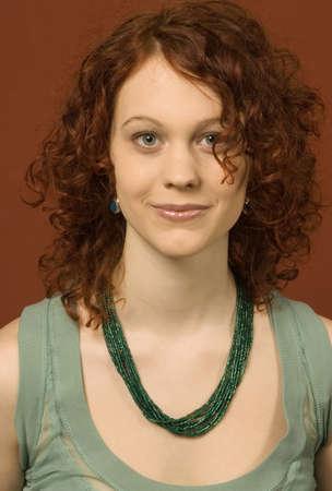 Young woman smiling, portrait LANG_EVOIMAGES