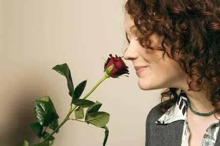 auras: Woman smelling rose LANG_EVOIMAGES