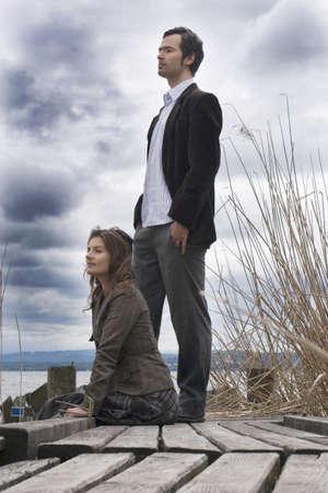 Couple sitting on jetty