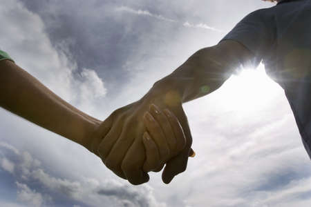 Man and woman holding hands,close-up