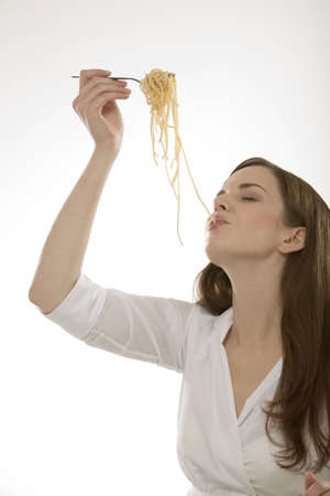 20 30 years: Woman eating noodles, portrait