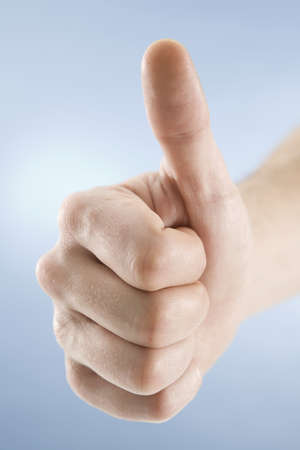 hand gesture: Hand gesture, thumbs up, close-up LANG_EVOIMAGES