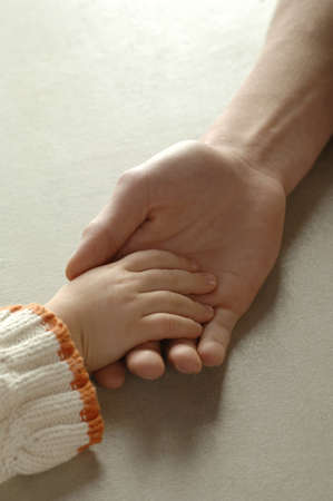 confiding: Two hands touching