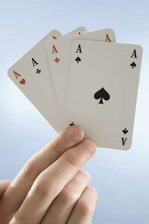 Hand holding aces, close-up