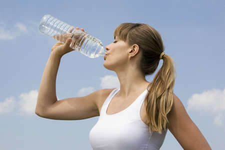 20 24 years: Young woman drinking water, portrait