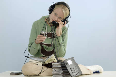 13 15 years: Tennage girl with headphone, telephones and cds LANG_EVOIMAGES