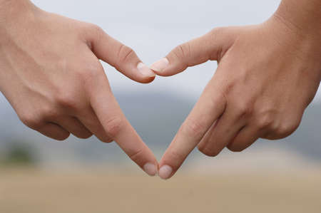 confiding: Two hands creating hart, close-up