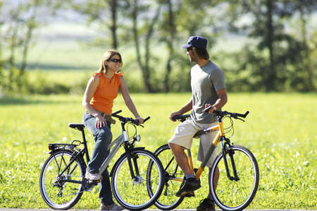 activewear: Germany, Bavaria, couple riding bicycle