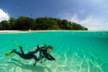 scuba woman: Philippines Dalmakya Island woman scuba diver in sea underwater view LANG_EVOIMAGES