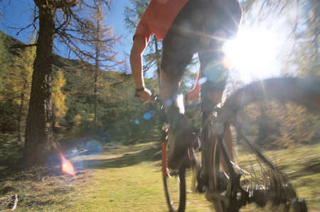 exhilaration: Boy riding bicycle low angle view LANG_EVOIMAGES