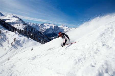 range of motion: Skier downhill alps LANG_EVOIMAGES