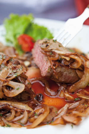 rump steak: Rump steak with stewed onions and herb butter close up