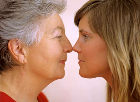 granddaughter: Grandmother and granddaughter face to face closeup LANG_EVOIMAGES