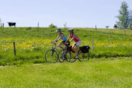 mountain biking: Germany Bavaria Oberland Two women mountain biking