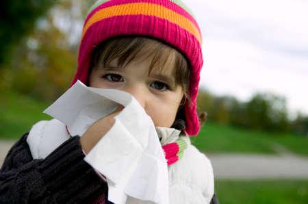 blowing nose: Girl 45 blowing nose closeup