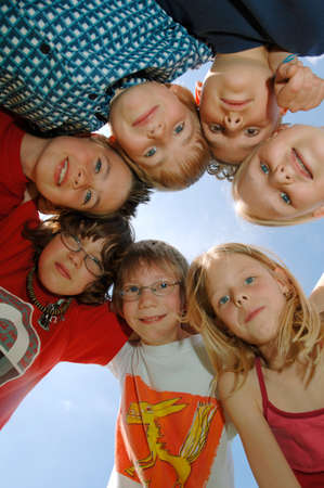 Children 69 in huddle low angle view portrait LANG_EVOIMAGES
