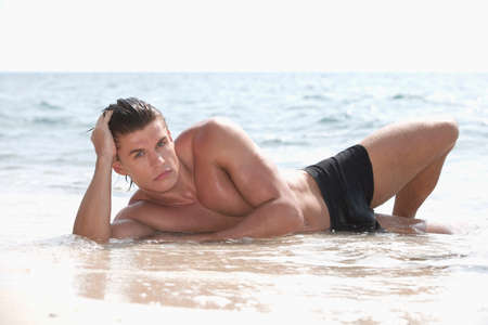 only men: Asia Thailand Young man relaxing on beach portrait