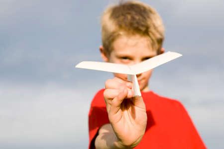 Boy 1013 holding paper plane closeup