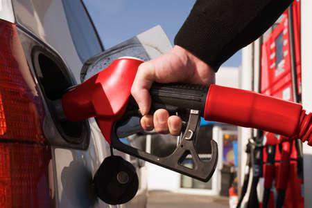 fuelling pump: Man refuelling car closeup