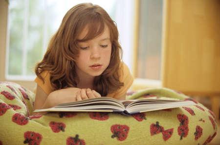 Girl 910 reading book closeup