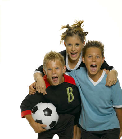 three people only: Teenage girl with boys with football shouting closeup LANG_EVOIMAGES