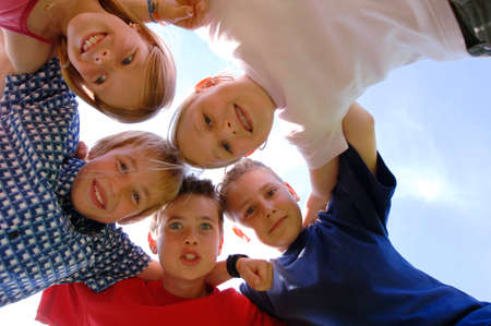 directly below: Children 6-9 years old in huddle low angle view portrait
