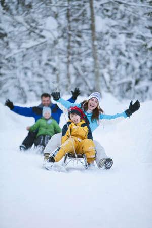 Germany Bavaria Family sledding having fun