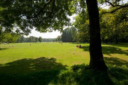 mixed age range: Germany Bavaria Munich Schwabing people in park LANG_EVOIMAGES