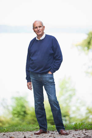 receding hairline: Germany Bavaria Starnberger See Senior man standing in front of lake