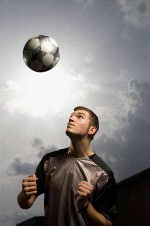 tricot: Man heading ball portrait closeup LANG_EVOIMAGES