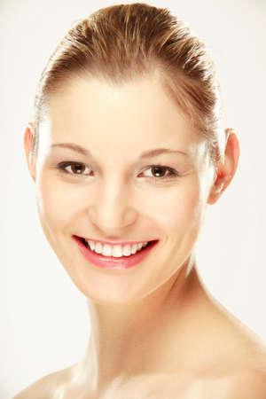 fair complexion: Young woman smiling portrait closeup
