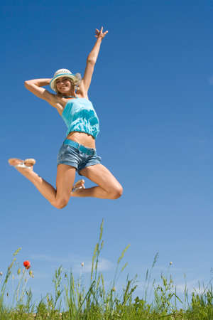 zest for life: Germany Bavaria Young woman jumping in meadow LANG_EVOIMAGES