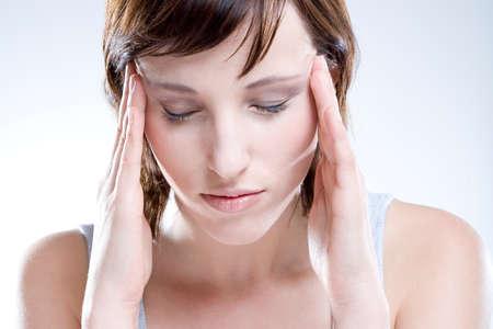 Woman hands on head portrait