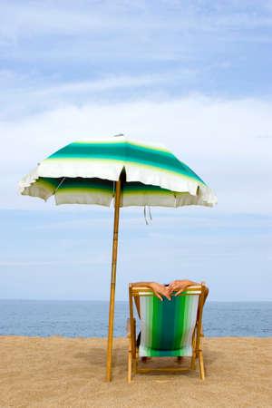 deckchair: Woman lying in deckchair at beach