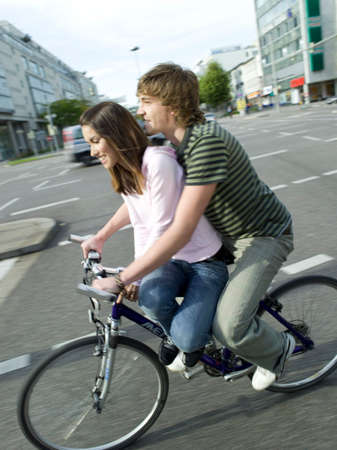 adulthood: Young couple on bike LANG_EVOIMAGES