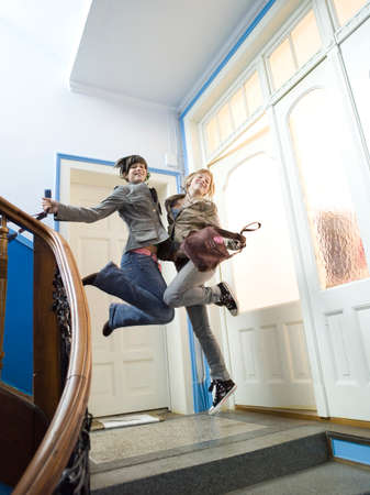 zest for life: Two girls jumping on staircase LANG_EVOIMAGES