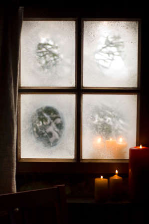 tranquil atmosphere: Austria Salzburger Land Candles burning on windowsill LANG_EVOIMAGES