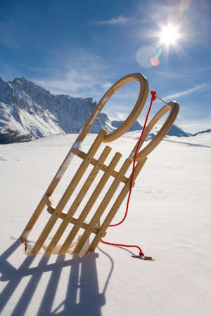 mountainscape: Switzerland Graubuenden Savognin Winter scenery with sledge LANG_EVOIMAGES